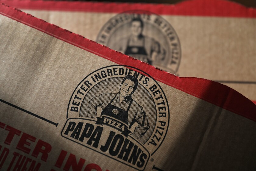 In this photo illustration, a Papa John's pizza box is seen on July 11, 2018 in Miami, Florida. The founder of Papa John's pizza, John Schnatter, apologized Wednesday for using the N-word on a conference call in May.