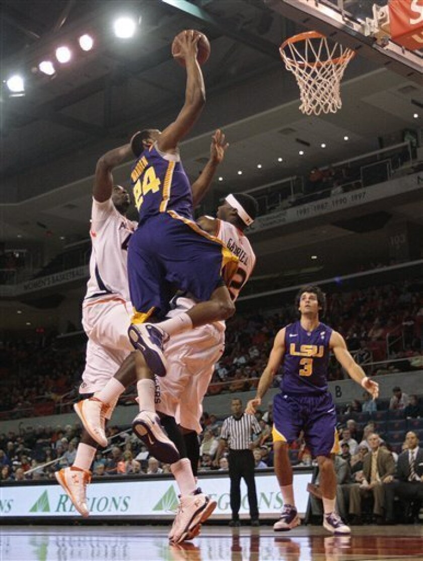 LSU's Storm Warren (24) shoots over the defense of Auburn's Kenny Gabriel (22) and Adrian Forbes, left, in the first half of their NCAA college basketball game at Auburn Arena in Auburn, Ala., Saturday, Jan. 8, 2011. LSU won 62-55. (AP Photo/Dave Martin)