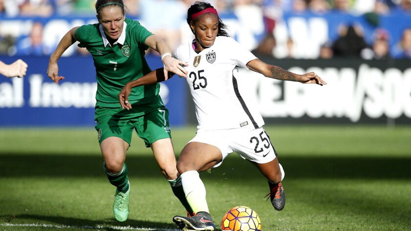 U.S. midfielder Crystal Dunn looks to pass against Ireland's Diane Caldwell during their exhibition game Saturday.