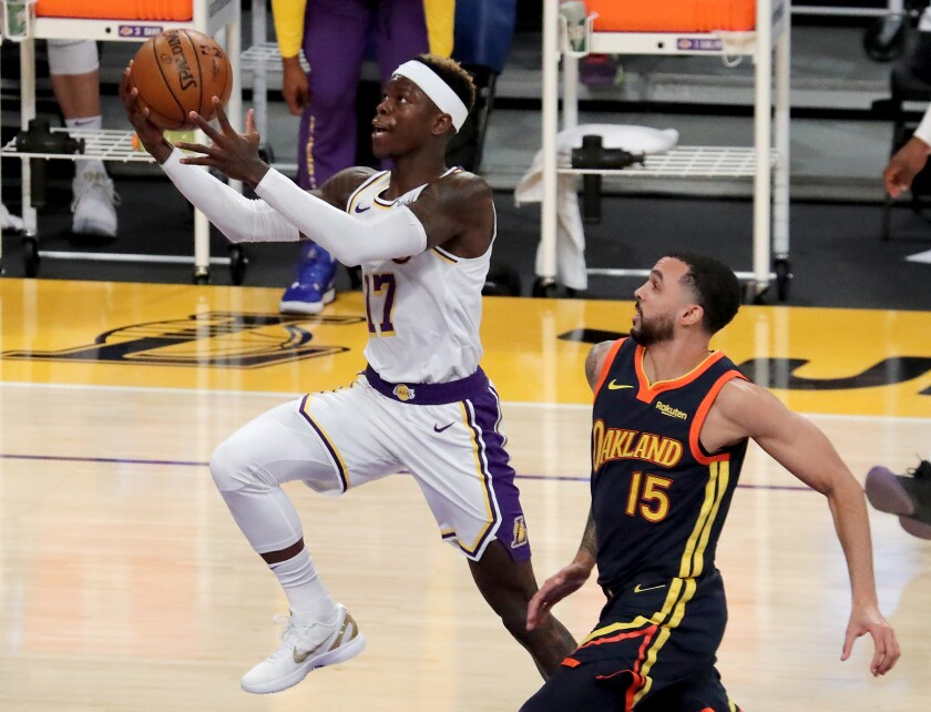 Lakers guard Dennis Schroder drives to the basket for a layup against Warriors guard Mychal Mulder.
