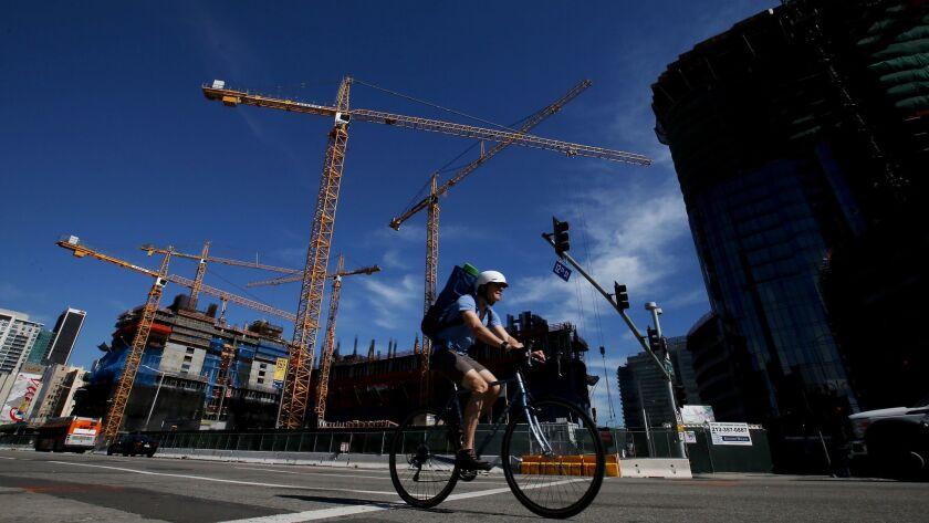 LOS ANGELES, CALIF. - MAR. 2, 2017. Construction cranes loom over a development site along Figuero