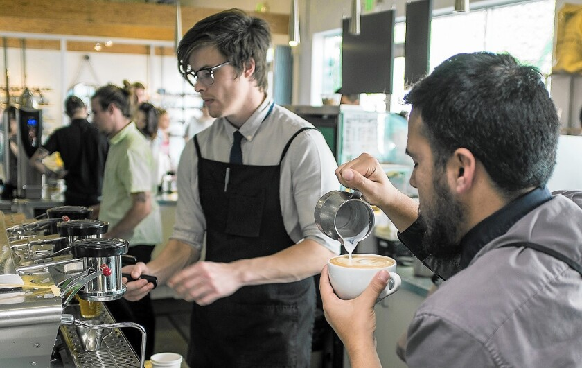 Baristas keep busy at Portola Coffee in The Mix in Costa Mesa.