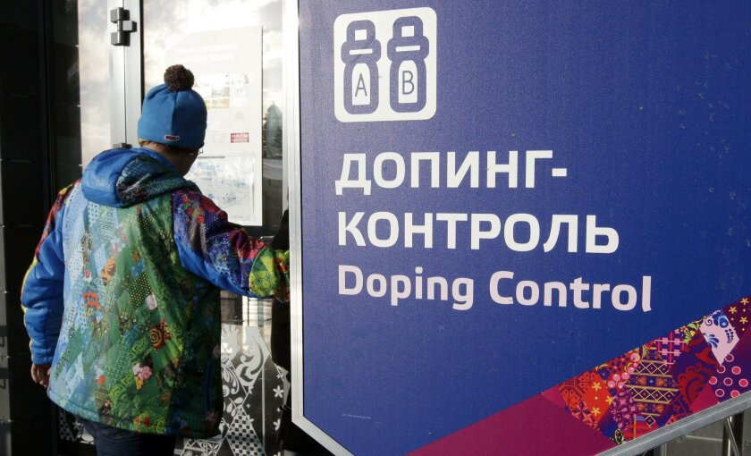 FILE - In this Feb. 21, 2014, file photo, a man walks past a sign reading doping control, at the Laura biathlon and cross-country ski center, at the 2014 Winter Olympics in Krasnaya Polyana, Russia. Russia says it supports retesting drug test samples from the 2014 Sochi Olympics after accusations it operated a mass doping program at the games. (AP Photo/Lee Jin-man, File)