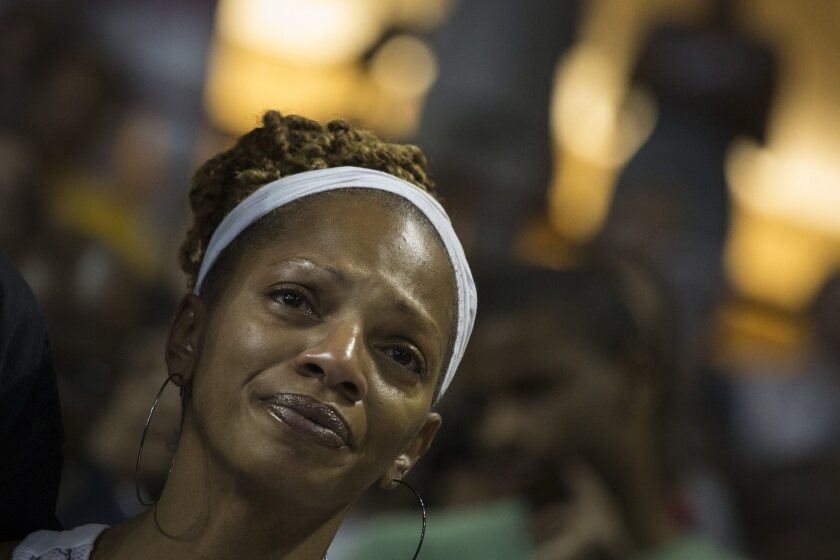 A woman reacts during a vigil for church shooting victims at TD Arena in Charleston, S.C., on Friday night.