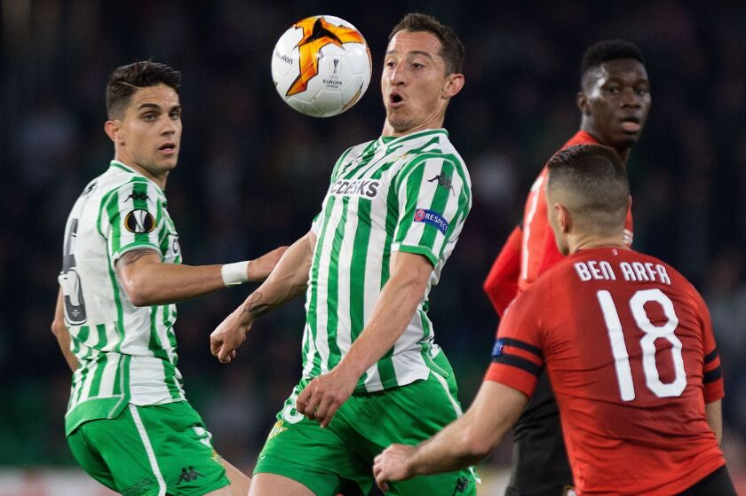 Real Betis' Mexican midfielder Jose Andres Guardado (C) eyes the ball next to Rennes' French forward Hatem Ben Arfa during the UEFA Europa League round of 32 second leg football match between Real Betis and Rennes at the Benito Villamarin stadium in Sevilla on February 21, 2019.