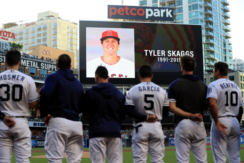Players for the San Diego Padres and San Francisco Giants stand during a moment of silence for pitcher Tyler Skaggs of the Los Angeles Angels of Anaheim at PETCO Park on July 01, 2019 in San Diego, California. Skaggs passed away in his hotel room earlier in the day in Texas.