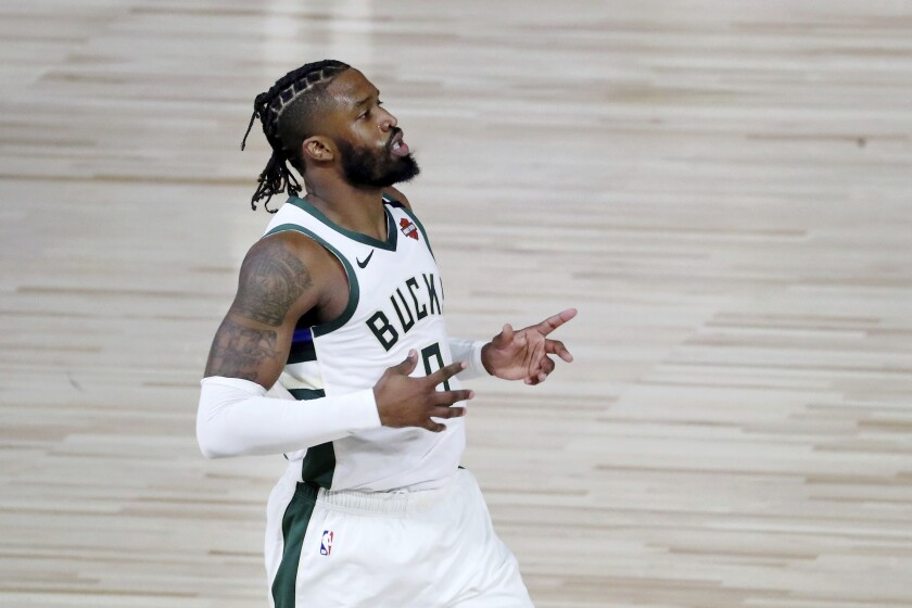 Wesley Matthews, playing for Milwaukee, retreats on defense after making a three-pointer against Orlando during the playoffs.