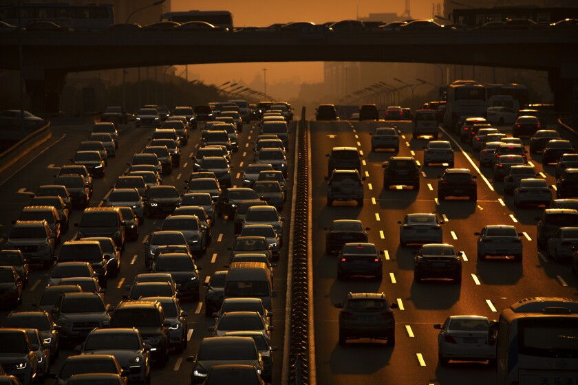 An expressway during rush hour in Beijing. Governments will gather soon in Madrid for an annual climate change meeting.