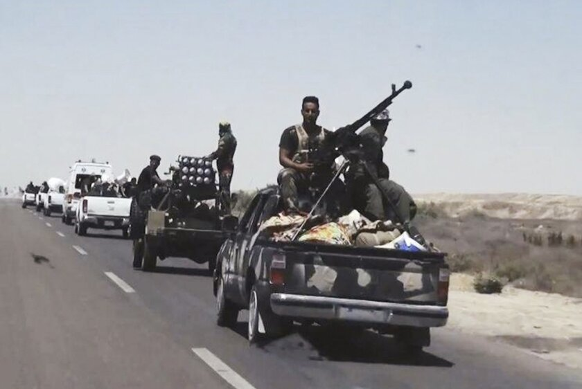 """File- This July 13, 2015, file photo shows Iraqi security forces backed by Shiite and Sunni pro-government fighters preparing to attack Islamic State group positions in Fallujah, 40 miles (65 kilometers) west of Baghdad, Iraq. Iraqi Prime Minister Haider al-Abadi announced the beginning of military operations to retake the Islamic State-held held city of Fallujah, west of Baghdad in a televised address Sunday, May 22, 2016. Iraqi forces are """"approaching a moment of great victory"""" against the Islamic State group, al-Abadi said surrounded by top military commanders from the ministry of defense and the country's elite counter terrorism forces. Fallujah has been under the control of IS for more than two years. (AP Photo, File)"""