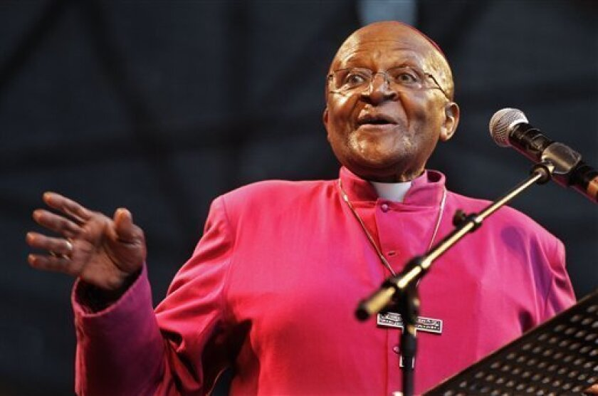 FILE - In this Sunday, Nov. 27, 2011 file photo South African Archbishop Desmond Tutu speaks during a climate justice rally held in Durban, South Africa, ahead of the official start or a two-week international climate conference. Three Nobel Peace Prize laureates, including Archbishop Desmond Tutu, have contested the awarding of this year's prize to the European Union, saying the 27-nation bloc contradicts the values associated with the prize because it relies on military force to ensure security. In an open letter to the Nobel Foundation, Tutu of South Africa, Mairead Maguire of Northern Ireland and Adolfo Perez Esquivel from Argentina demanded that the prize money of 8 million kronor ($1.2 million) not be paid out this year. (AP Photo/Schalk van Zuydam, File)