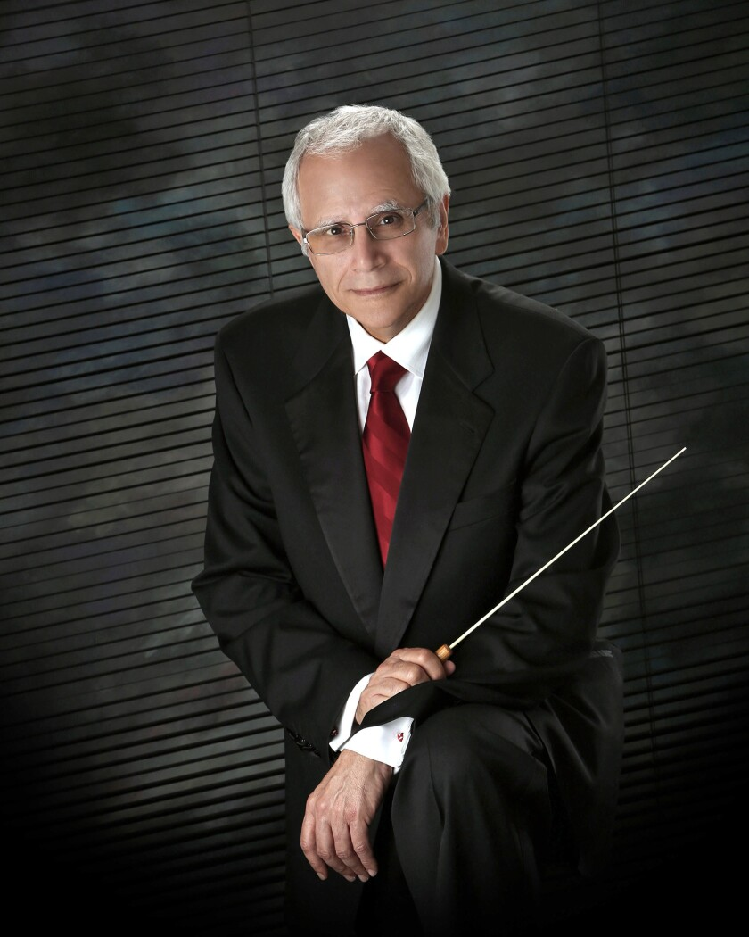"""Norman Mamey conducts the new Premiere Orchestra at a """"Christmas Musical Spectacular"""" at the Alex Theatre."""