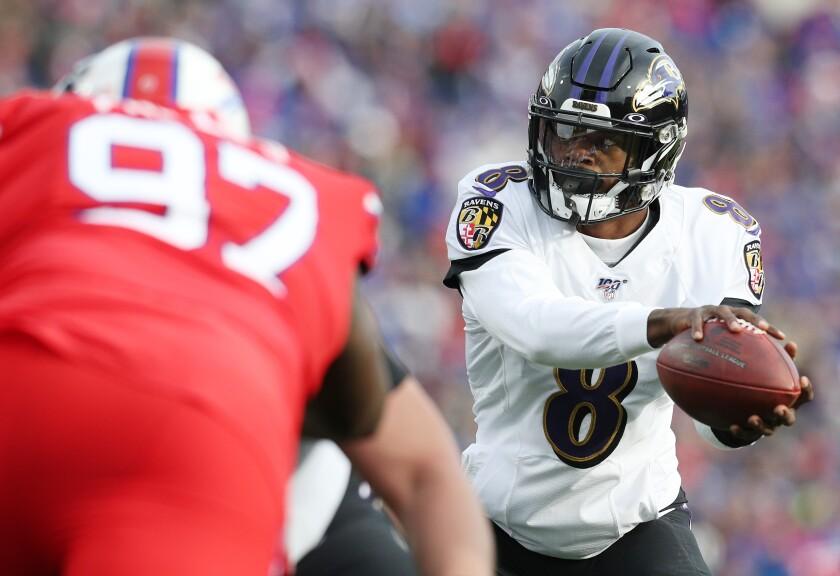 Baltimore Ravens quarterback Lamar Jackson takes a snap against the Buffalo Bills on Sunday.