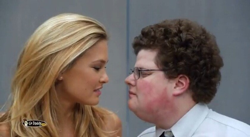 """GoDaddy's """"Perfect Match"""" Super Bowl commercial featured a kiss between model Bar Refaeli and a man portraying an archetypal tech nerd."""