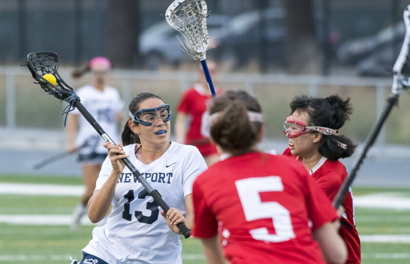 Newport Harbor's Delaney Knipp, seen looking for a shot under pressure from Tesoro's Yujin Lee and Sydney Duke on March 13, 2018, helped the Sailors win the Sunset League title in 2019.