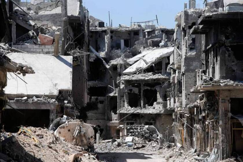 Syrians seek shelter in a city of rubble