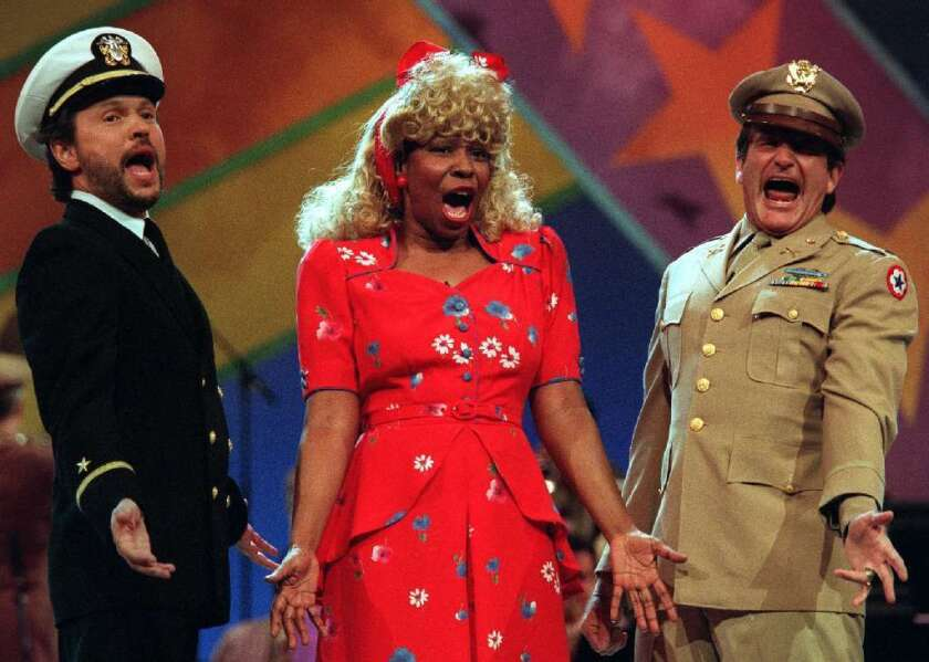 """Robin Williams was at his most memorable doing manic comedy. He's pictured here at right teaming up with Billy Crystal and Whoopi Goldberg on a """"Comic Relief"""" fundraiser."""