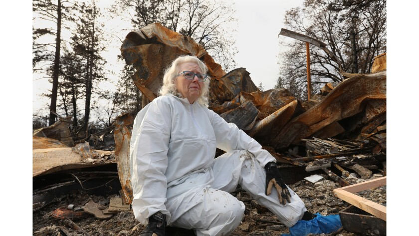 PARADISE, CALIFORNIA--DEC. 5, 2018--Ann Rahlf sifts through the remains of her home in Paradise. She
