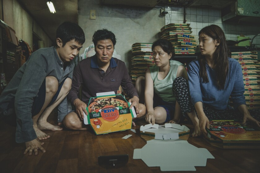 "Woo Silk Choi, Kang Ho Song, Lee Jeong Eun and Kim So Dam in a scene from Bong Joon Ho's ""Parasite."""
