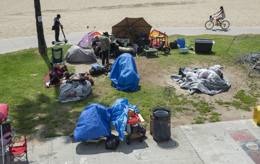 A homeless encampment on a boardwalk in Venice Beach.
