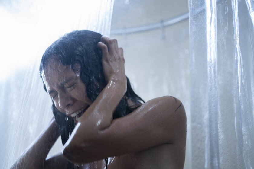 """Sivan Alyra Rose clasps her hands to the side of her head in the shower in """"Chambers."""""""
