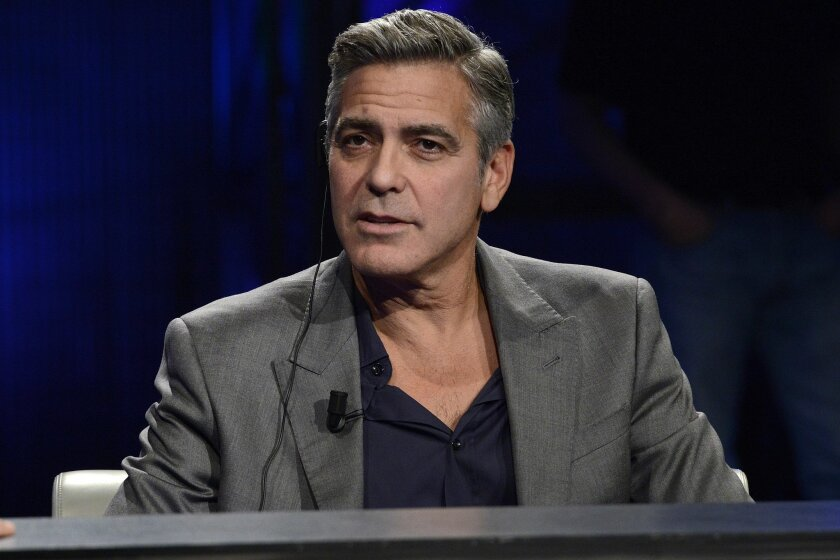 """FILE - This Sunday, Feb. 9, 2014 file photo shows American actor George Clooney interviewed by Fabio Fazio during the Italian State RAI TV program """"Che Tempo che Fa"""", in Milan, Italy. Hollywood's most eligible bachelor may be getting hitched. A London law firm on Monday April 28, 2014, has congratu"""
