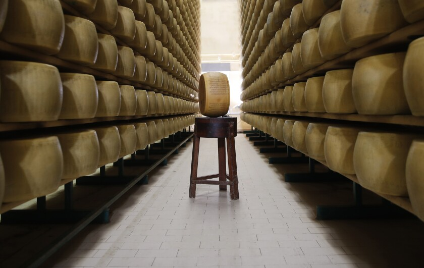 In this photo taken Tuesday, Oct. 8, 2019, Parmigiano Reggiano Parmesan cheese wheels are stored in Noceto, near Parma, Italy. U.S. consumers are snapping up Italian Parmesan cheese ahead of an increase in tariffs to take effect next week. The agricultural lobby Coldiretti on Friday, Oct. 11, 2019, said sales of both Parmigiano Reggiano and Grana Padano, aged cheeses defined by their territory of origin, have skyrocketed by 220% since the higher tariffs were announced one week ago. (AP Photo/Antonio Calanni)