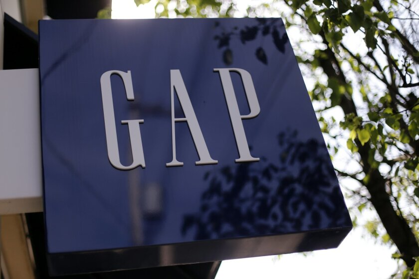 FILE - This May 14, 2014 file photo shows the sign on a GAP store in the Shadyside section of Pittsburgh. The Gap Inc. reports quarterly financial results after the market closes Thursday, Feb. 26, 2015. (AP Photo/Gene J. Puskar, File)
