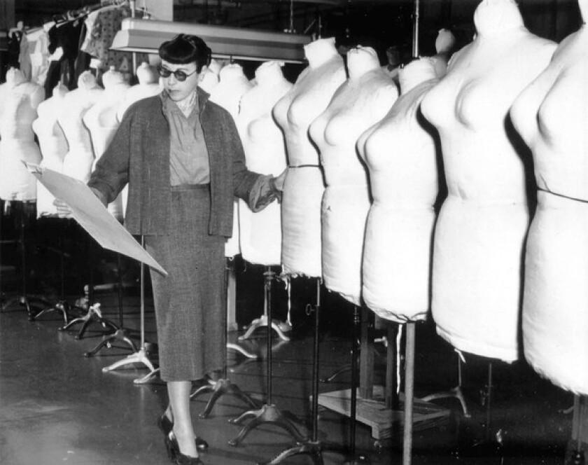 Costume designer Edith Head with celebrity mannequins.
