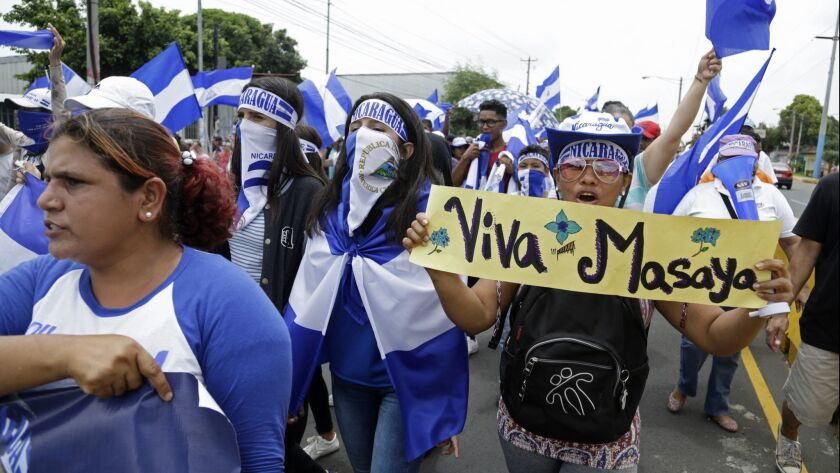 Demonstrators march to demand the resignation of President Daniel Ortega and the release of politica