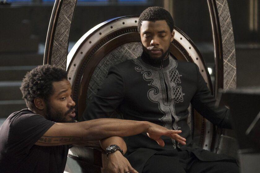 "Writer-director Ryan Coogler on the set of ""Black Panther"" with star Chadwick Boseman."