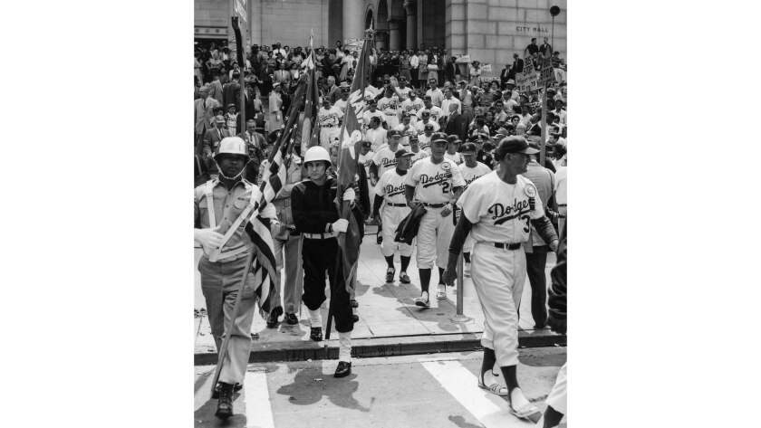 April 18, 1958: Members of the Dodgers leave reception at City Hall to play their first game at the