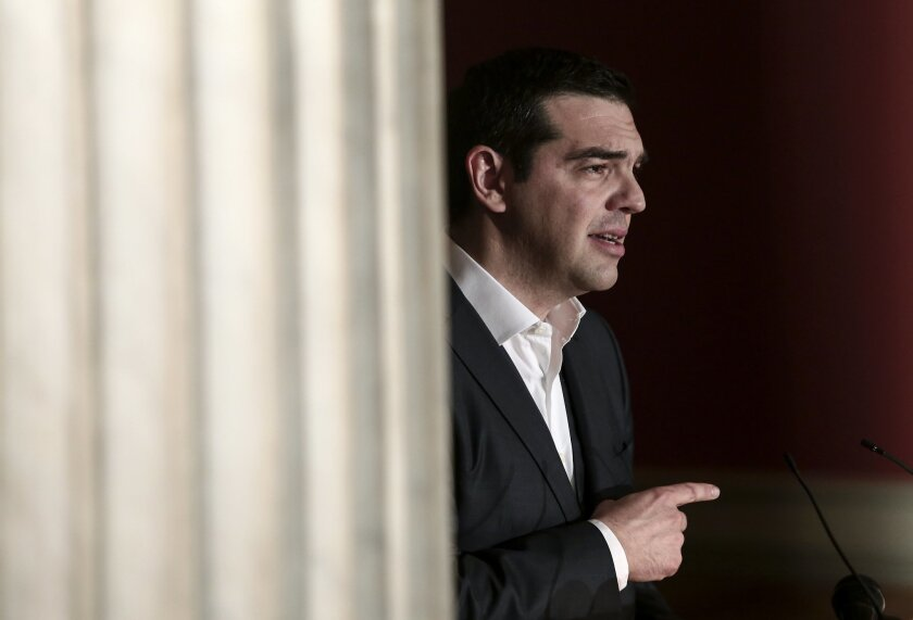 Greece's prime minister Alexis Tsipras delivers a speech at Athens University, Wednesday March 25, 2015. Tsipras' speech took place during a special gathering to commemorate Greece's Independence Day, which marks the start of the uprising against the Ottomans back in 1821. (AP Photo/Panayiotis Tzam