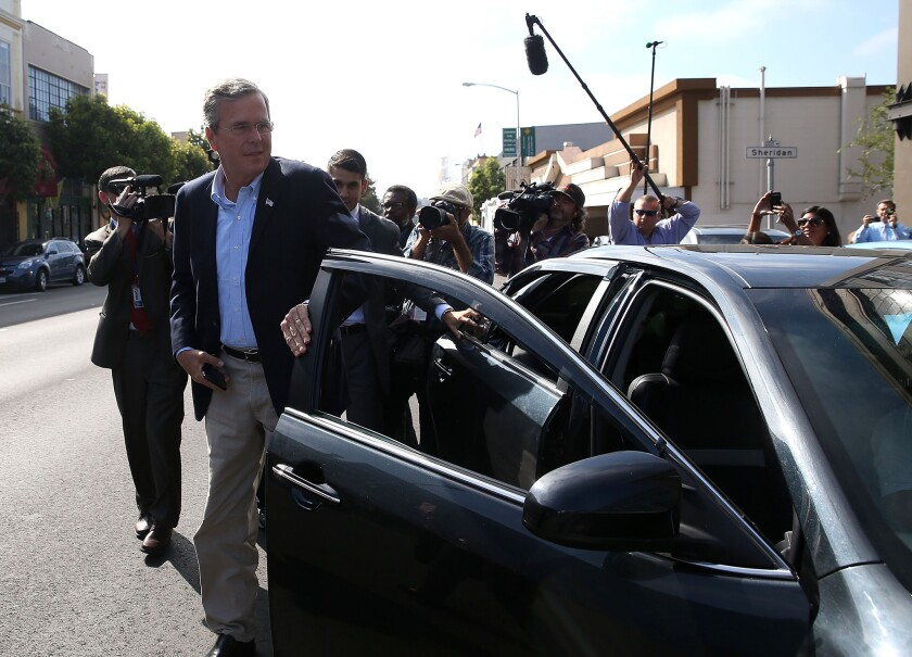 Republican presidential candidate Jeb Bush gets out of an Uber car as he arrives at a campaign stop in San Francisco.