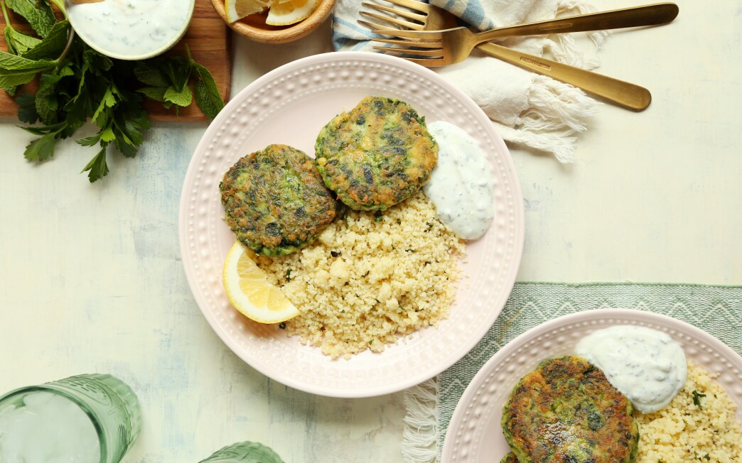 Green peas add brightness to these pan-fried falafel-like patties served with lemony couscous and a bright yogurt sauce.