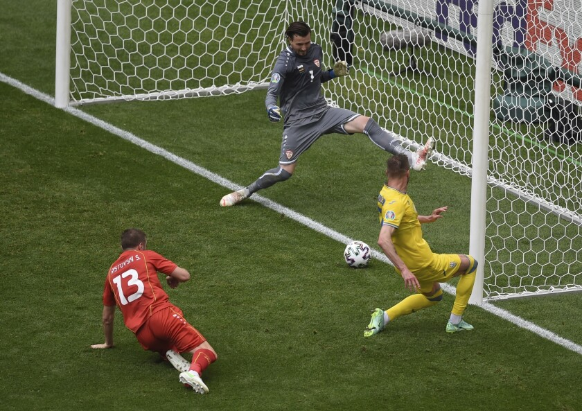 Ukraine's Andriy Yarmolenko scores his side's opening goal during the Euro 2020 soccer championship group C match between Ukraine and North Macedonia at the National Arena stadium in Bucharest, Romania, Thursday, June 17, 2021. (AP Photo/Mihai Barbu, Pool)