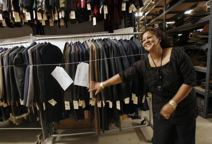 FILE - In this Dec. 14, 2006, file photo, Costume designer Sharen Davis looks through clothes at The Motion Picture Costume Co., in Burbank, Calif. The Academy of Motion Picture Arts and Sciences announced its newly elected board of governors on Monday, July 18, 2016. The list includes six first-ti