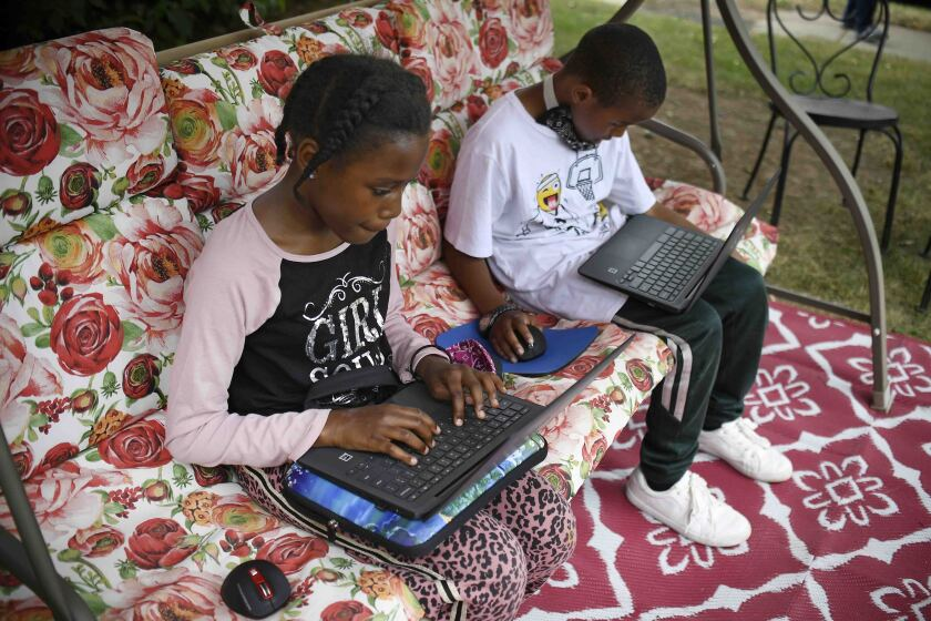 Kids working on their laptops