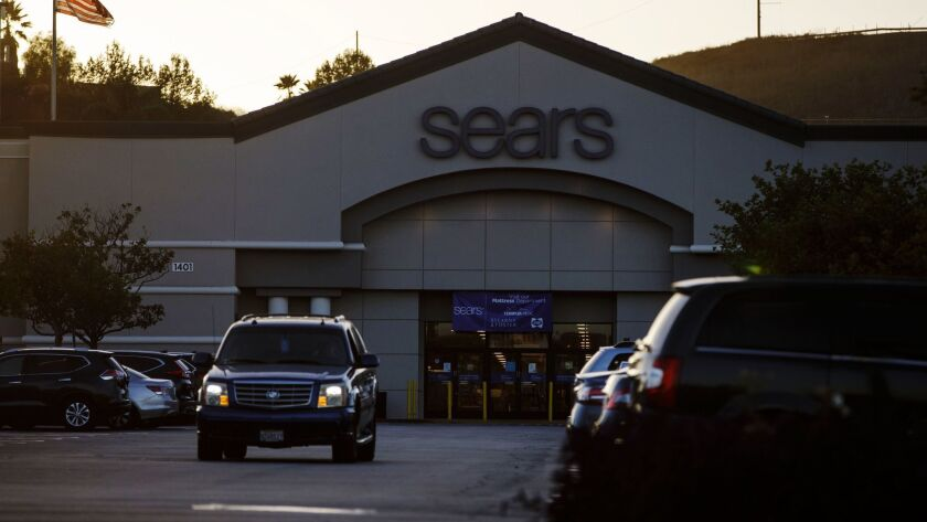 A car drives through the parking lot of a Sears store in Montebello in October. The store has since shut down.