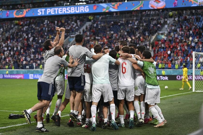 Spain players celebrate their win during the Euro 2020 soccer championship quarterfinal match between Switzerland and Spain, at the Saint Petersburg stadium in Saint Petersburg, Friday, July 2, 2021. (Kirill Kudryavtsev, Pool via AP)