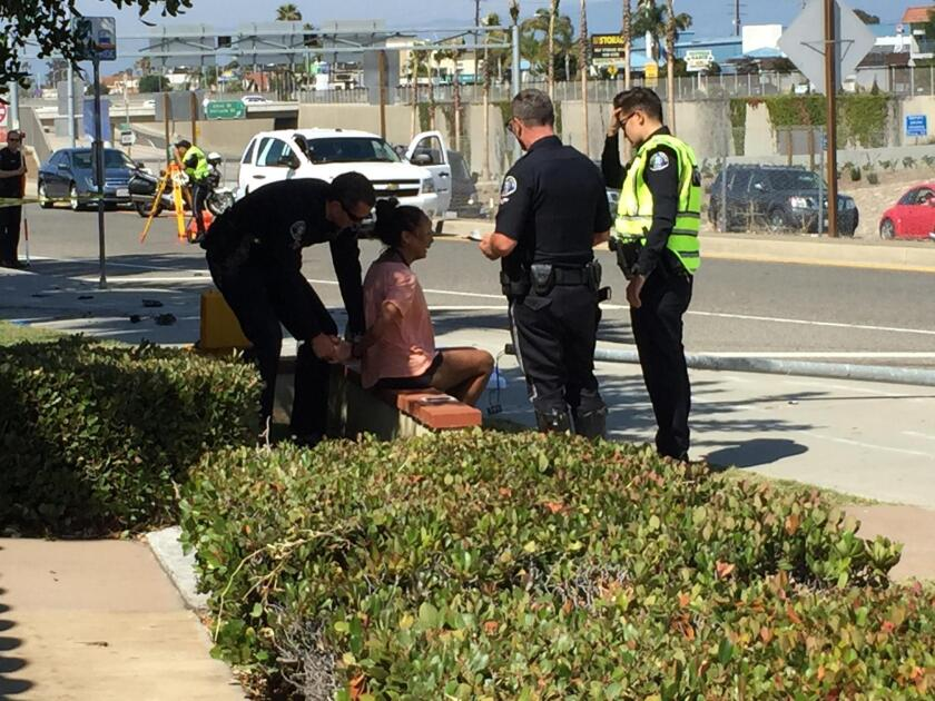 A woman is arrested Friday after a Mercedes-Benz SUV struck and killed a pedestrian on a crosswalk along Newport Boulevard in Costa Mesa. Police identified the woman as the SUV's driver, Anna Marie McPherson of Irvine.