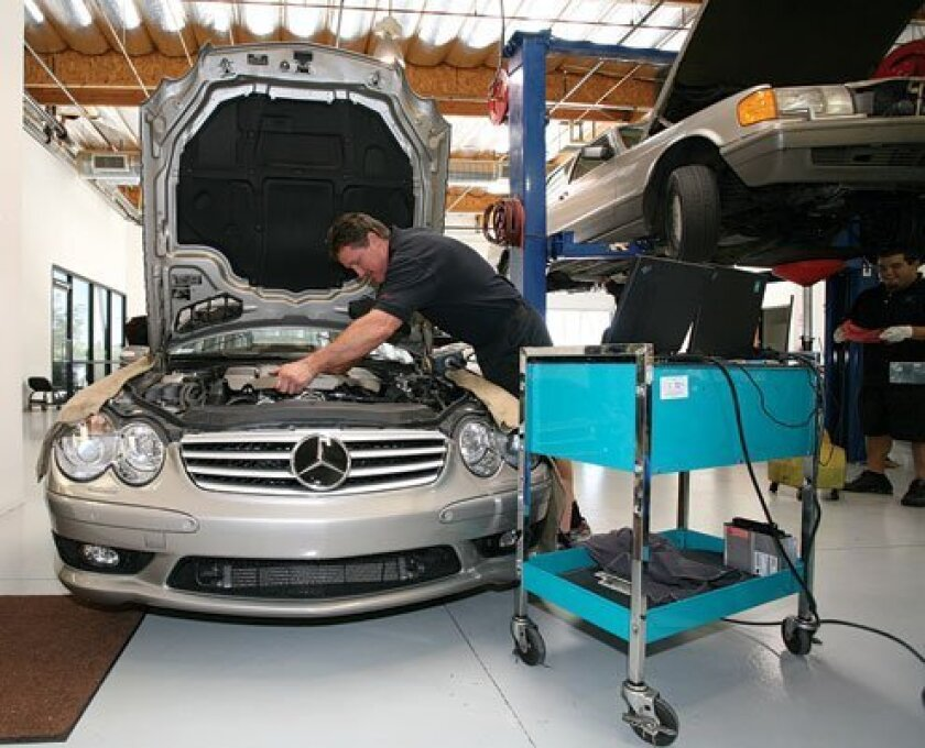 Michael Floyd, co-owner of 1st Avenue European, works on a Mercedes Benz.