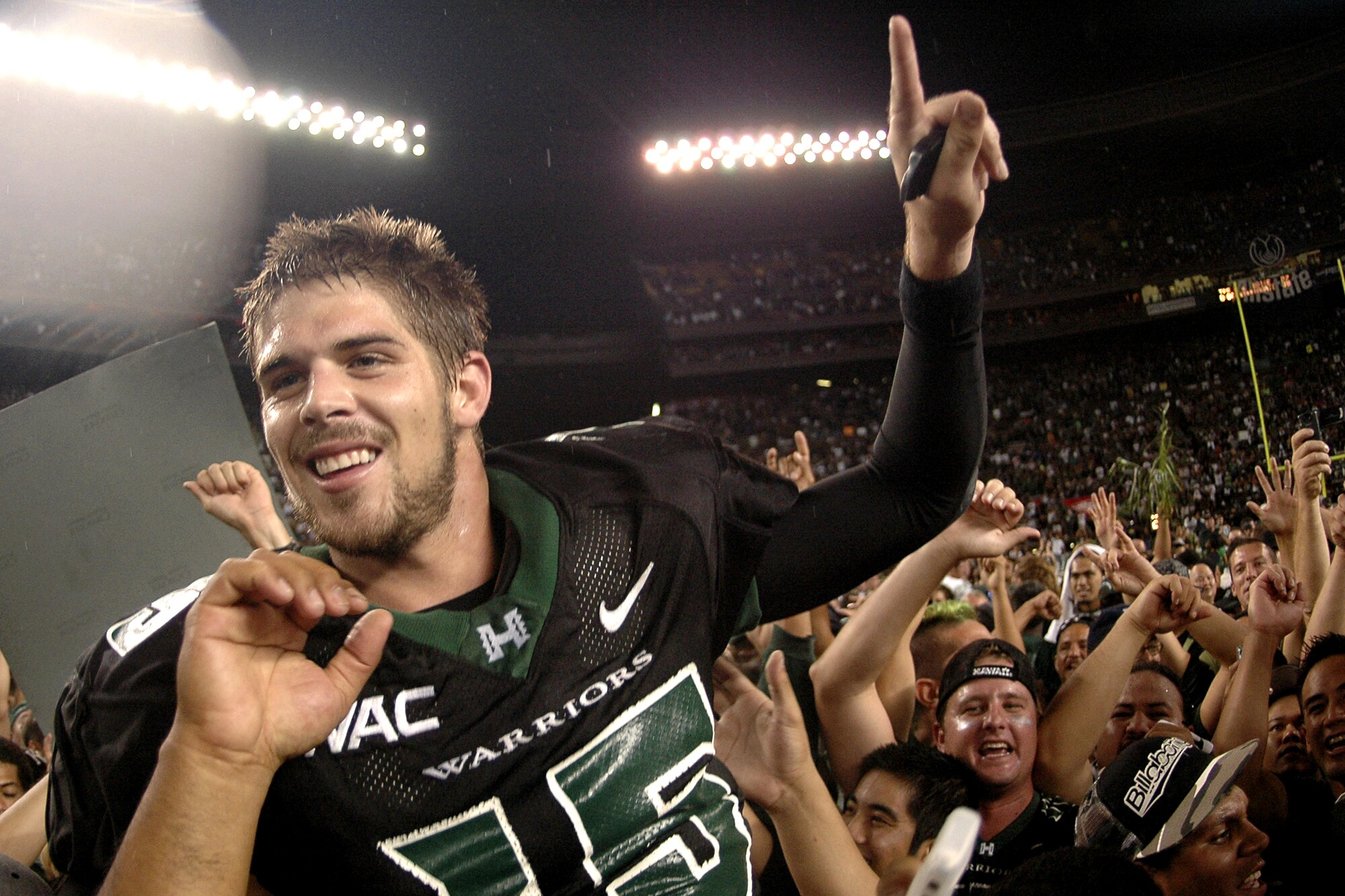 Colt Brennan celebrates after leading Hawaii to victory over Boise State on Nov. 23, 2007.