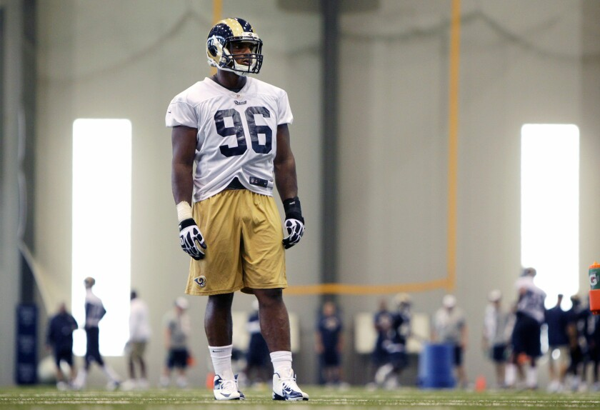 St. Louis defensive end Michael Sam practices during the first day of training camp for rookies in Earth City, Mo., on July 22.