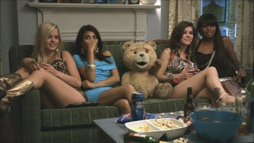 """The talking bear character Ted (voiced by Seth MacFarlane) relaxes with hookers in the movie """"Ted."""""""