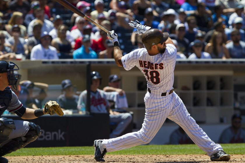 Padres Austin Hedges flies out to short left field against the Atlanta Braves Wednesday afternoon.
