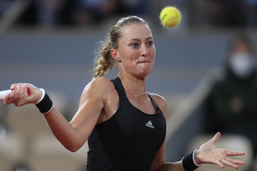 France's Kristina Mladenovic plays a shot against Germany's Laura Siegemund in the first round match of the French Open tennis tournament at the Roland Garros stadium in Paris, France, Tuesday, Sept. 29, 2020. (AP Photo/Michel Euler)