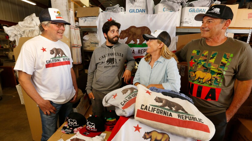 Kevin Greenwood, Willie Travis and his parents Martie and Mark Travis, left to right, all manage The Dolphin Shirt Company.