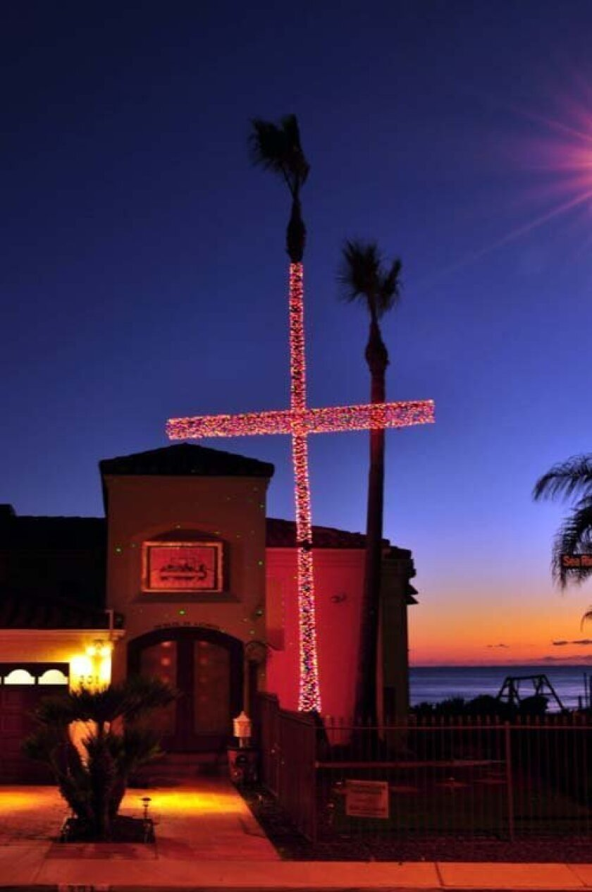 A lighted cross shines over the Kholi home in Bird Rock. Greg Wiest photos