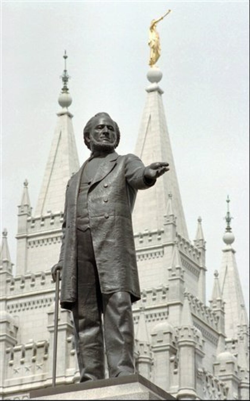 FILE - In this April 1, 1998 file photo, a statue of Mormon pioneer leader Brigham Young stands in front of The Church of Jesus Christ of Latter-day Saints' Temple in Salt Lake City. Latter-day Saints are anxious about what's ahead. Republican Mitt Romney is about to become the first Mormon nominee