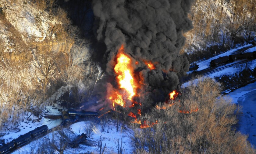 Flames erupt from a train that derailed March 4 near Galena, Ill., spilling crude oil near the intersection of the Mississippi and Galena rivers.